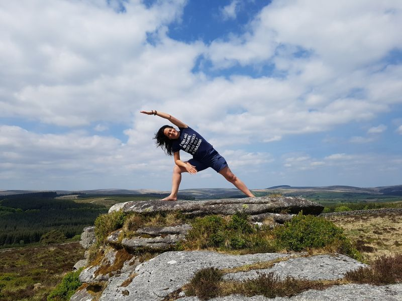 Donna from Simply Soulful Yoga doing a yoga pose on Dartmoor