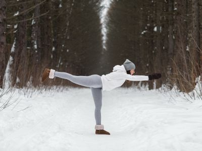 Yoga in a Snowy Forest